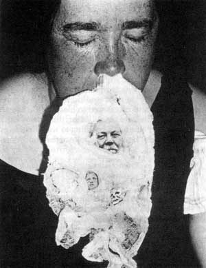 "1931 photograph of a Winnipeg medium with an obviously fraudulent ectoplasmic ""apparition"" of Conan Doyle one year after the author's death. Source: University of Manitoba, Archives and Special Collections, T. G. Hamilton Collection"